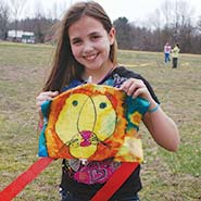 Photo of girl with handmade kite